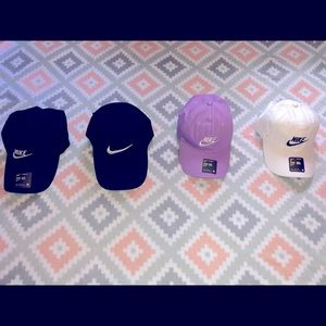 Brand new Nike hats with tags.